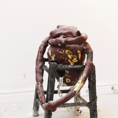 'Linger'. 2017. Found ceramics, air hardening clay, inner tube, paper bag, acrylic, metal chain, gloss paint, spray paint, wooden chair, polyfiller. 0.57 x 0.48 x 0.38m.