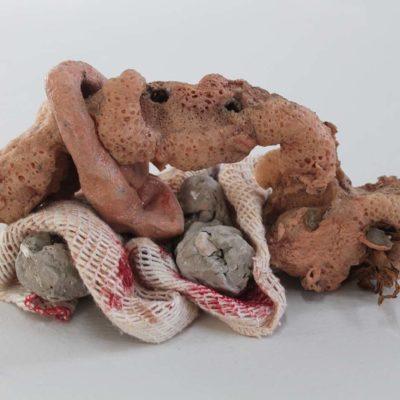 'Slid'. 2018. Polyurethane foam, unfired clay, cloth, air drying clay, dried leaf, plaster, pigment, gravel. 30 x 12 x 4cm.